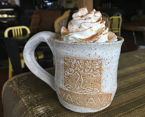 coffe with whipped cream in a handmade Vacavi Cup